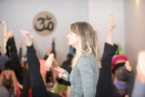 Tricia teaching a class at Yoga Daily